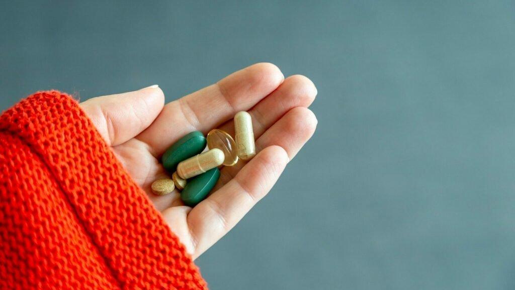 Hand Holding Daily Supplement Pills