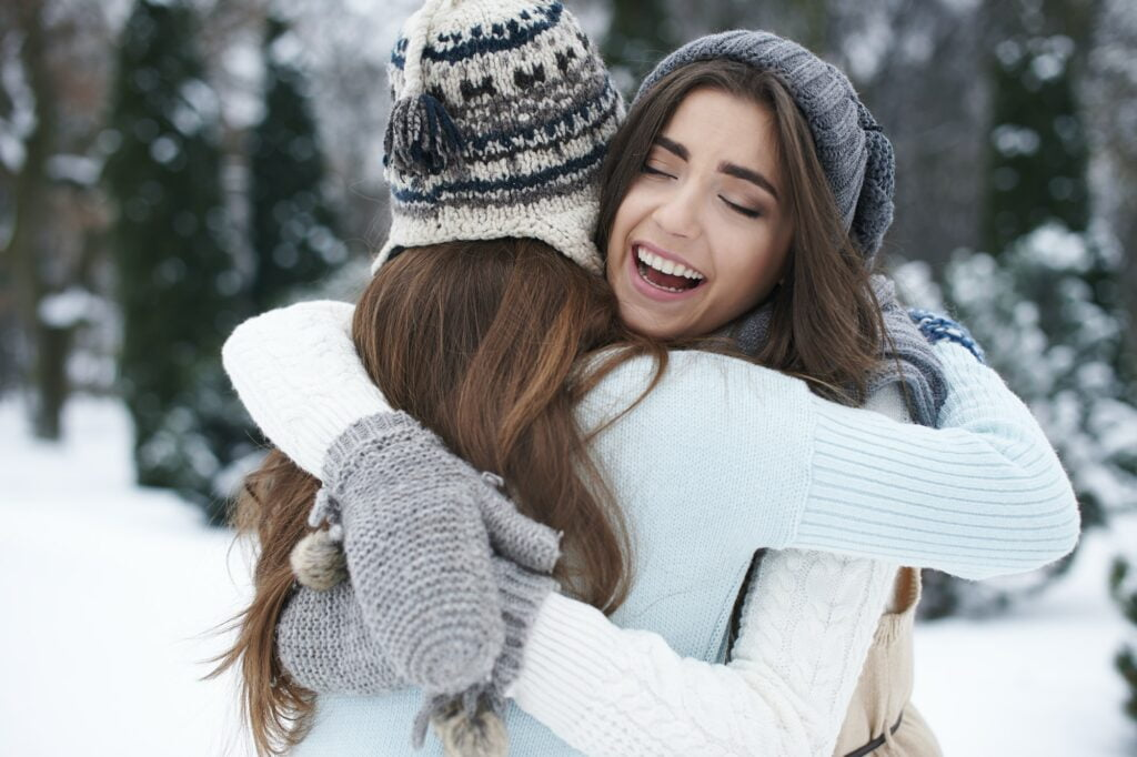 Best Friends Hugging in Winter